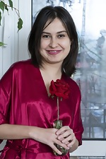Eva Black poses with her red rose nearby